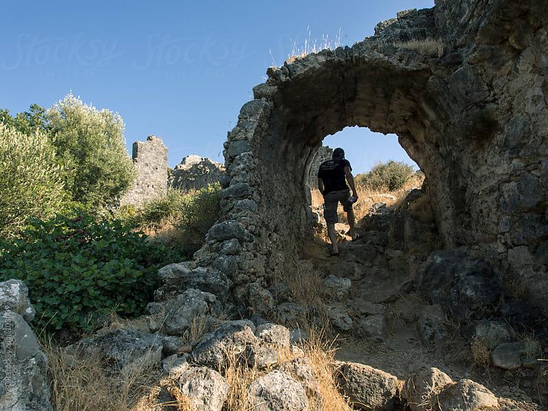 Man walking among ruins on Gemiler Island, Fethiye, Turkey by DV8OR for Stocksy United