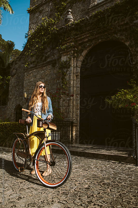 Hipster woman with bicycle by Stephen Morris for Stocksy United