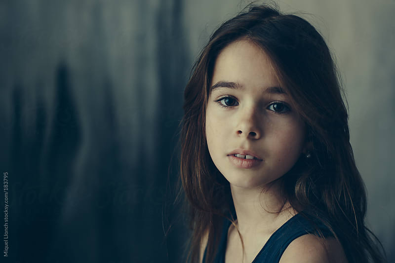 Portrait of a young girl by Miquel Llonch for Stocksy United