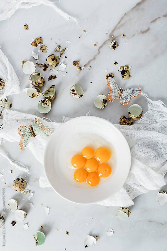 Quail eggs with butterflies by Tatjana Ristanic for Stocksy United