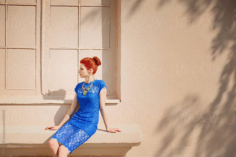 Red-haired girl in a blue dress  by Svetlana Shchemeleva for Stocksy United