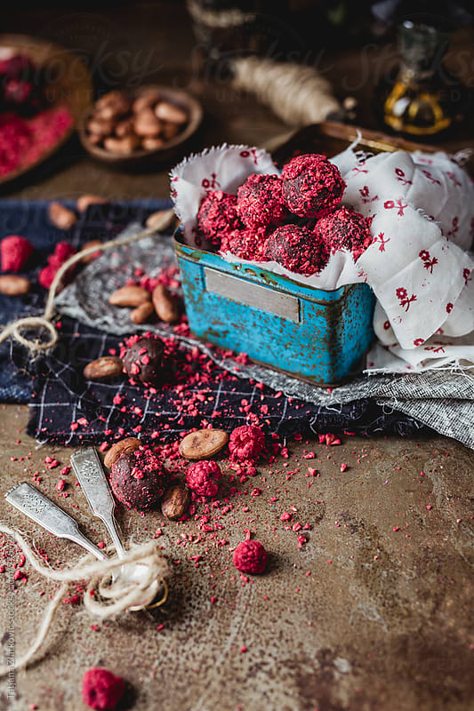 Chocolate truffles with dried raspberries and rum by Tatjana Ristanic for Stocksy United