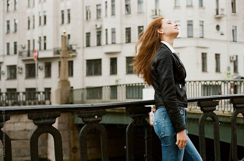Young woman enjoys wind  by Lyuba Burakova for Stocksy United