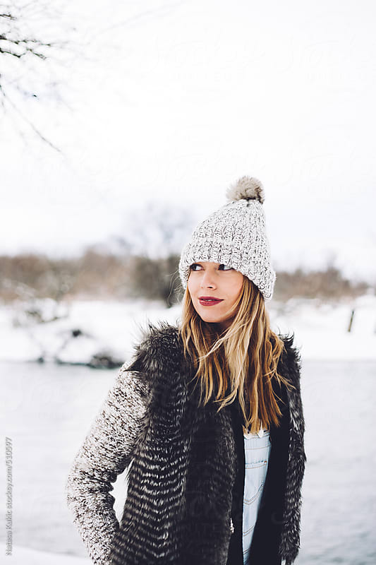 Young woman on a winters day by Natasa Kukic for Stocksy United