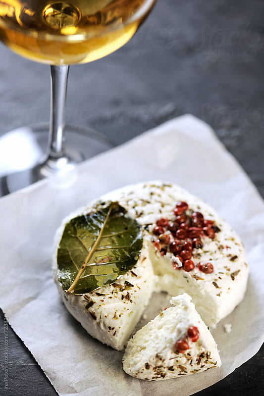 Marinated cream cheese and white wine by Ina Peters for Stocksy United