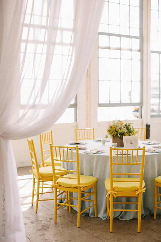 Wedding Reception with Yellow Chairs Drapes by Sidney Morgan for Stocksy United