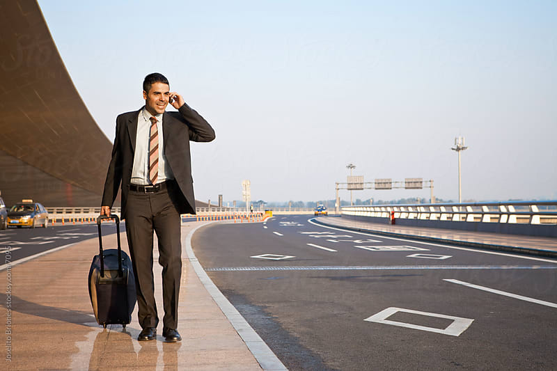 Traveling Hispanic/Latino Business Man in Beijing Airport, China by Joselito Briones for Stocksy United