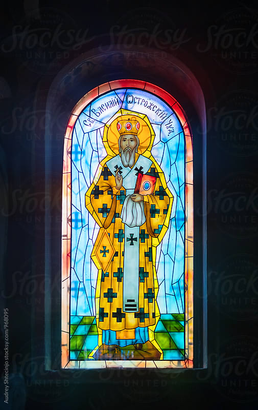 Detail of St. Basil on stained glass window in Orthodox Church. by Marko Milanovic for Stocksy United