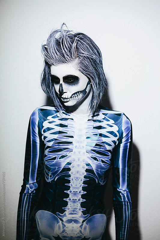Woman with halloween make up and skeleton costume by Aleksandar Novoselski for Stocksy United
