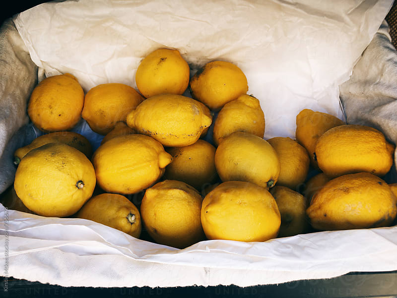 Crate of lemons by Kirstin Mckee for Stocksy United