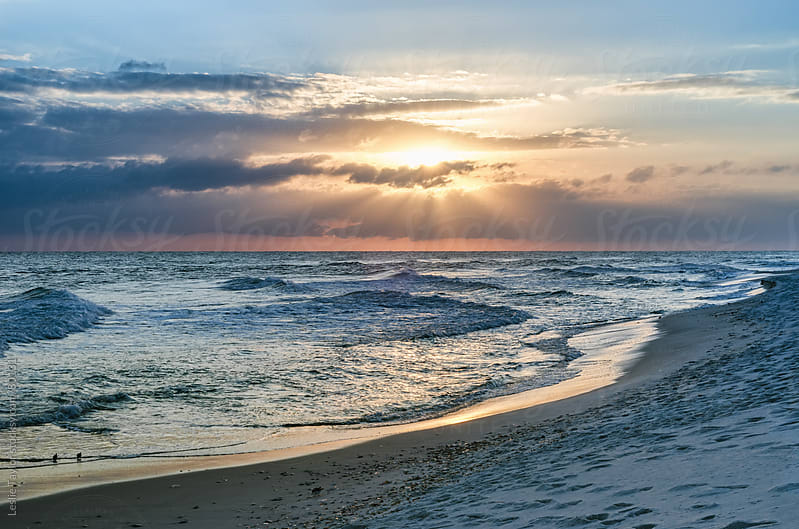 Sunbeam Sunset on Pensacola Beach by Leslie Taylor for Stocksy United
