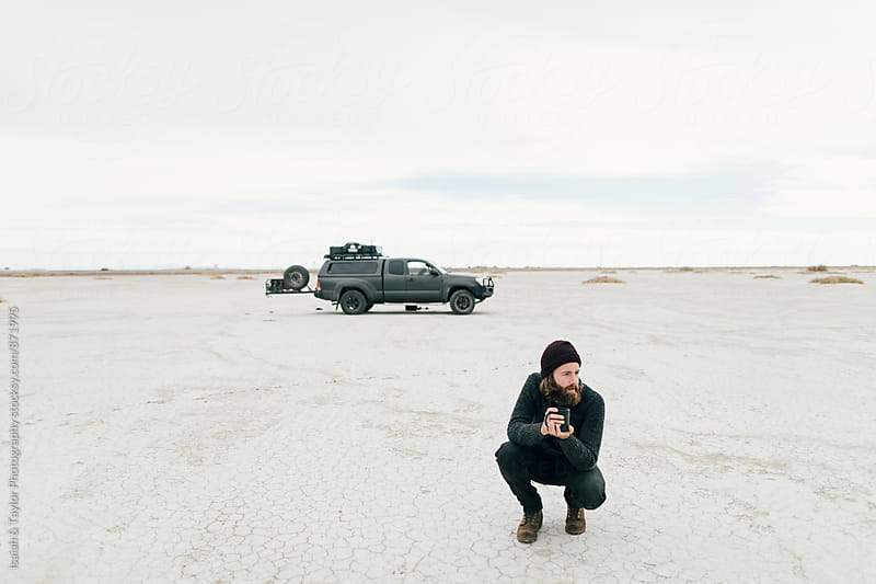 Man camping in desert by Isaiah & Taylor Photography for Stocksy United