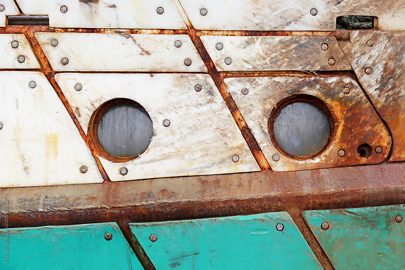 The hull of an old boat appears to have two eyes by Marcel for Stocksy United