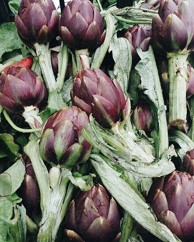 An artichokes in the market  by Anna Malgina for Stocksy United