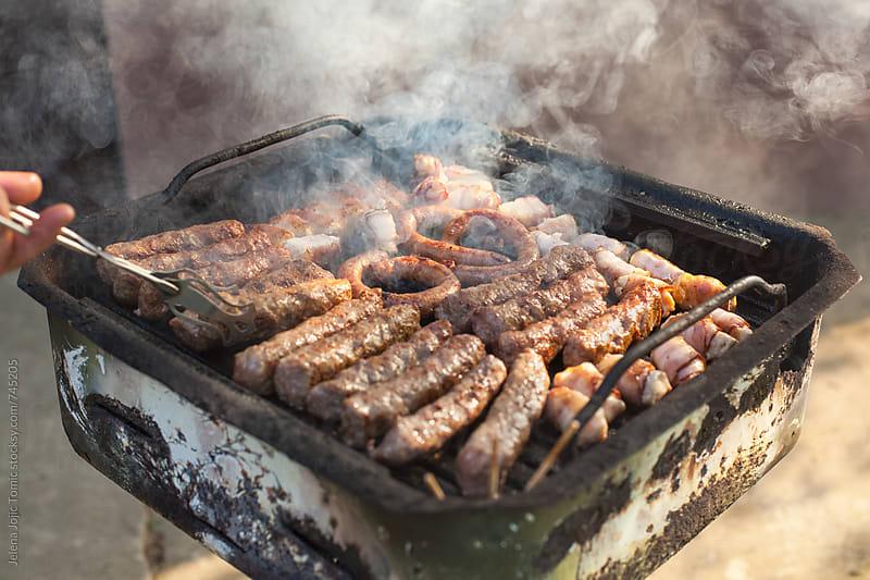 Family barbecue by Jelena Jojic Tomic for Stocksy United