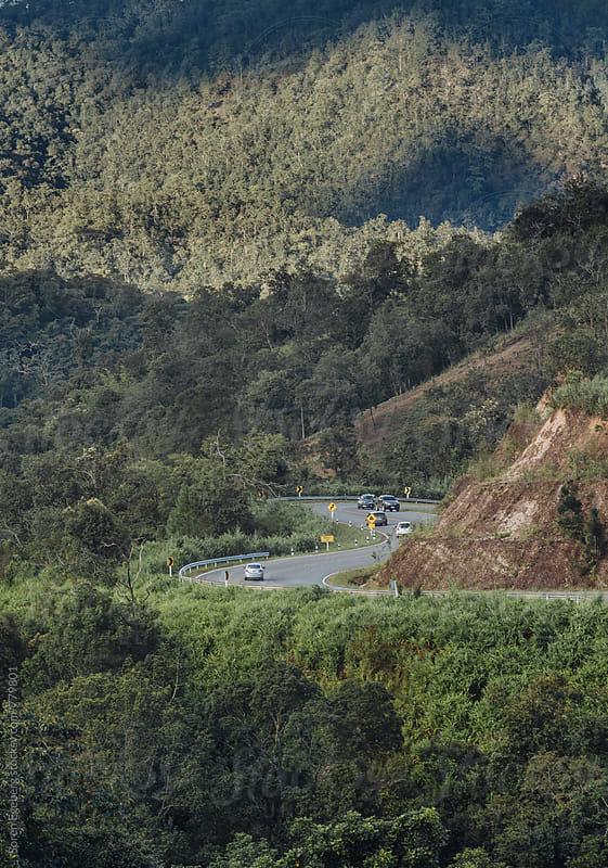 Winding road in mountain landscape by Soren Egeberg for Stocksy United