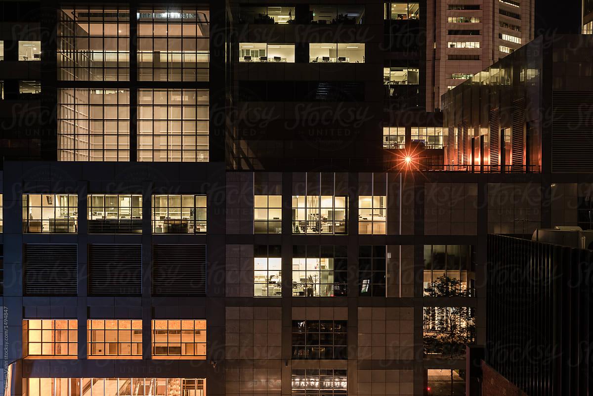 office buildings at night by Gillian Vann - Office, Night - Stocksy United