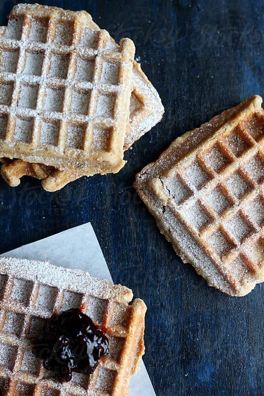 Sweet waffles with powderer sugar by Orsolya Bán for Stocksy United