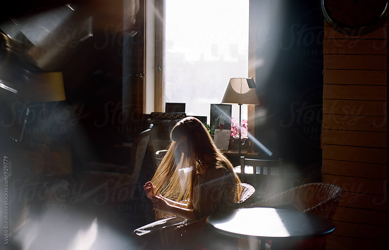 Woman in a cafe by Lyuba Burakova for Stocksy United