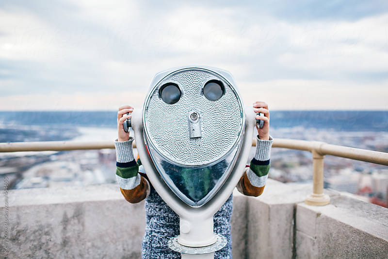 boy with coin operated binoculars as a face by Kelly Knox for Stocksy United