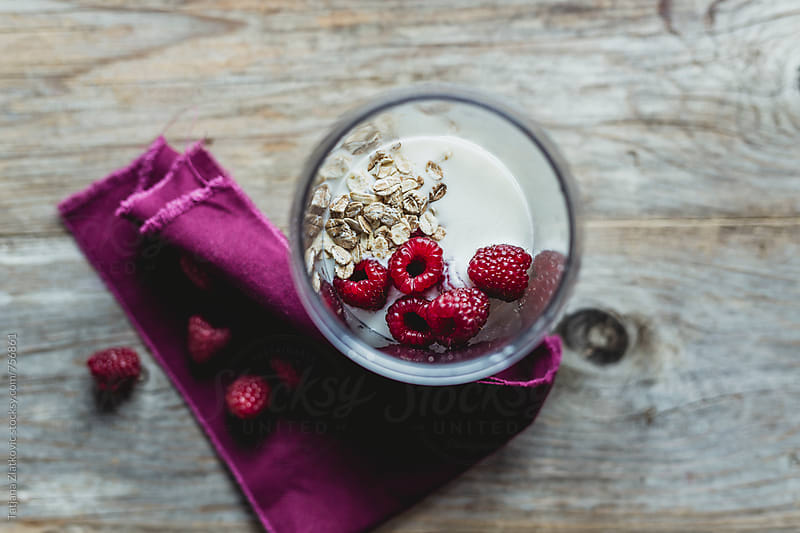 Ingredients for raspberry smoothie by Tatjana Zlatkovic for Stocksy United
