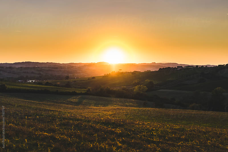 sunset on Tuscany countryside by Juri Pozzi for Stocksy United