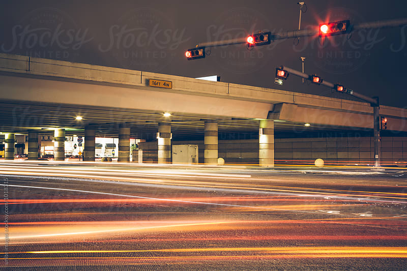 traffic at night in Houston, Texas by unite images for Stocksy United
