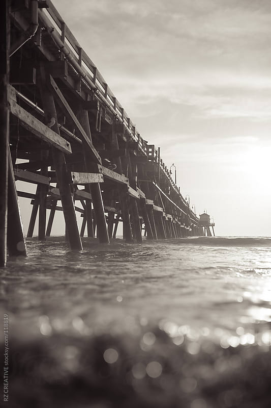 Black and white vertical image of a pier. by RZ CREATIVE for Stocksy United