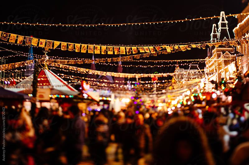Crowded winter fair in the evening  by Andrey Pavlov for Stocksy United