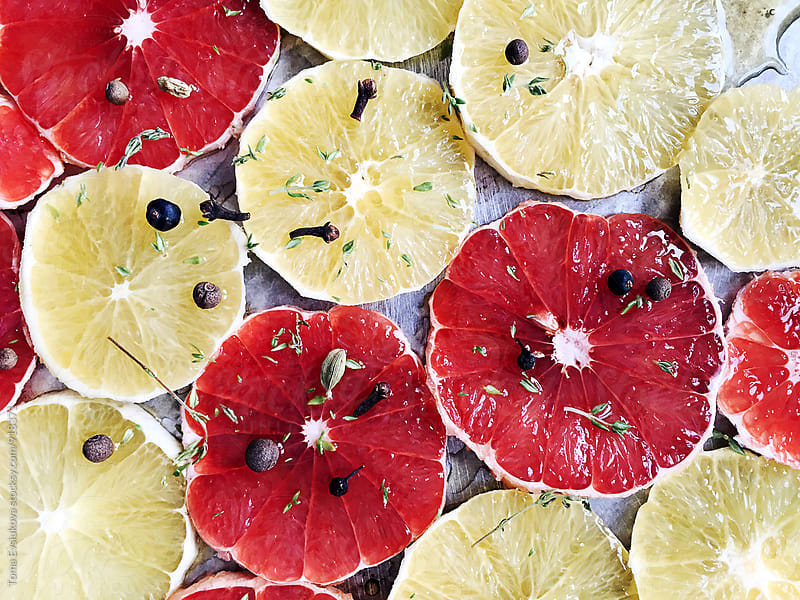 Orange and grapefruit slices with spices by Toma Evsiukova for Stocksy United