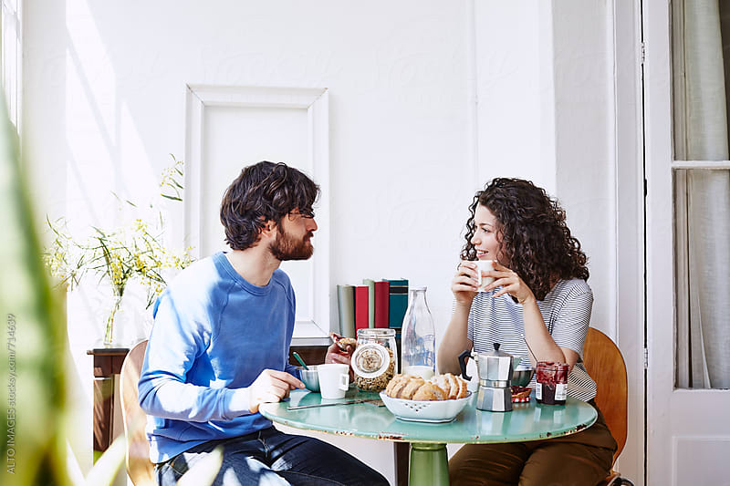 Couple Talking While Having Breakfast At Home by ALTO IMAGES for Stocksy United