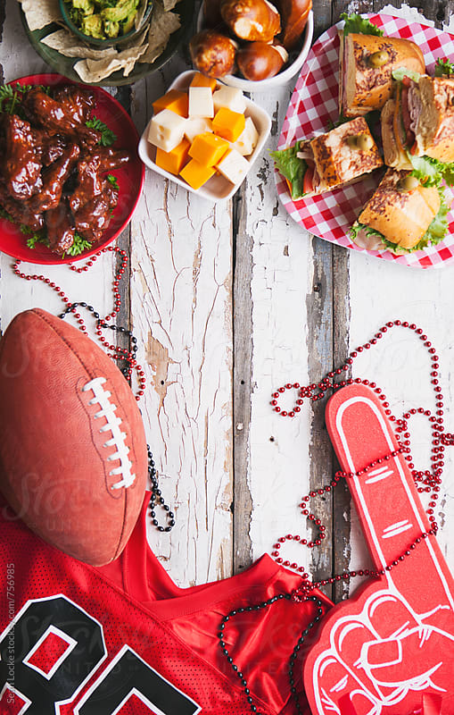 Football: Overhead View Of Tailgate Food And Sport Items by Sean Locke for Stocksy United