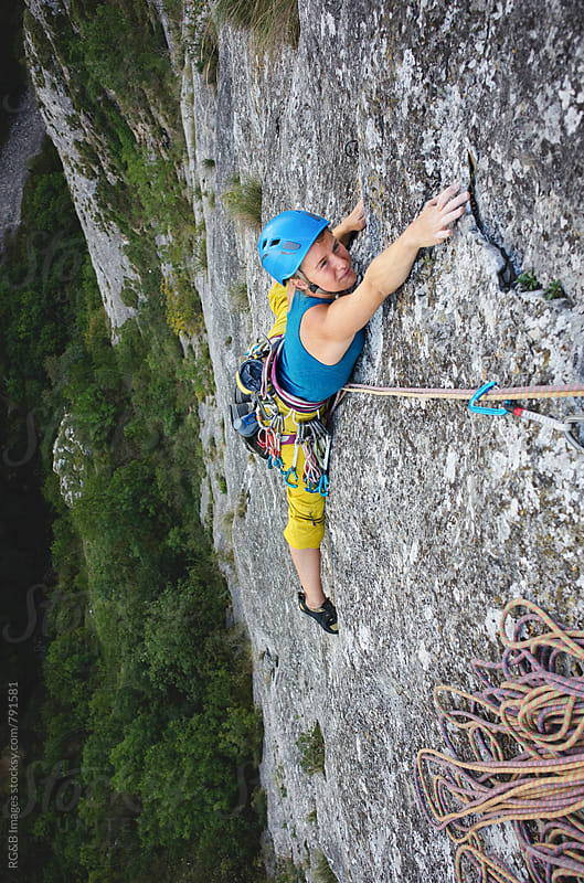 Rock climber reaching for the hold by RG&B Images for Stocksy United