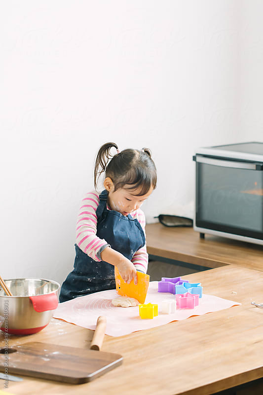 Toddler girl making cookies by MaaHoo Studio for Stocksy United