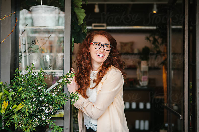 Flower shop owner standing in front of her store by Kristine Weilert for Stocksy United