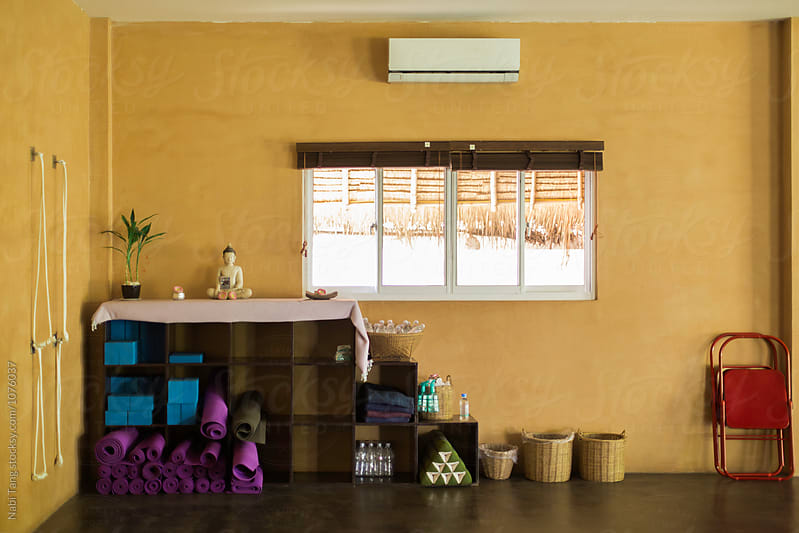 Shelf filled with yoga mat and equipment by Nabi Tang for Stocksy United