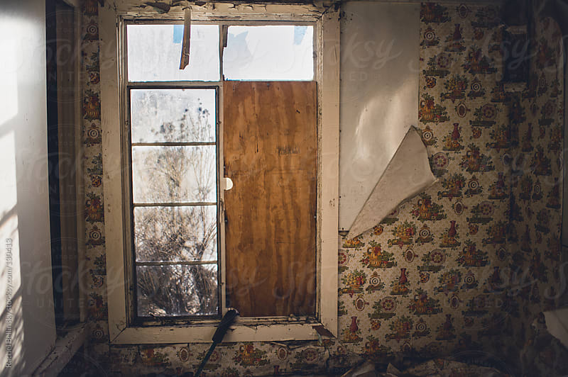 A room in an abandoned building with peeling wallpaper by Rachel Bellinsky for Stocksy United