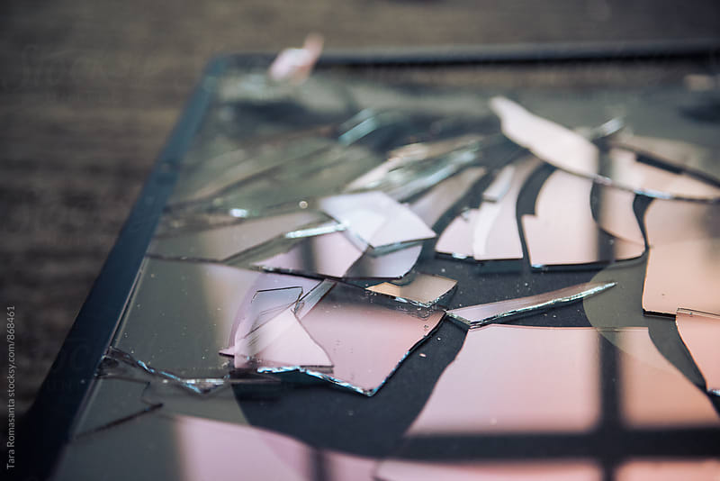 shattered glass, broken pieces by Tara Romasanta for Stocksy United