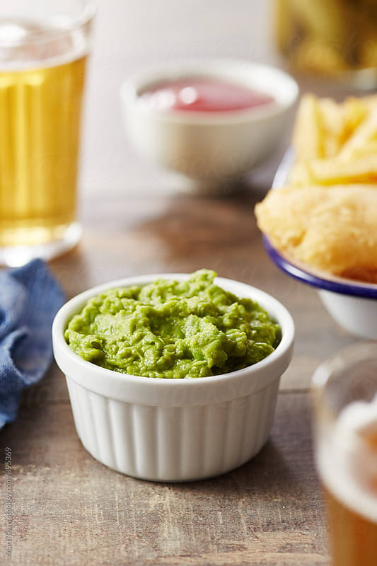 Traditional mushy peas on wooden table by Martí Sans for Stocksy United