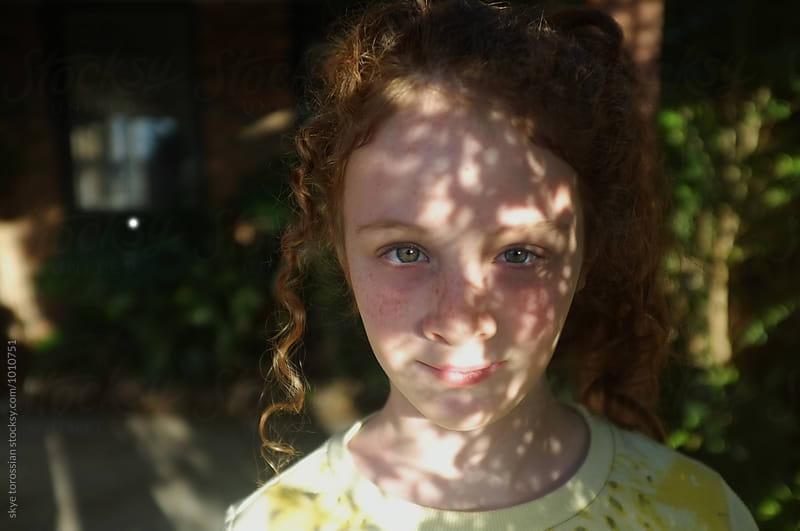 Portrait in dappled light by skye torossian for Stocksy United