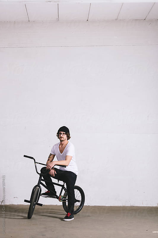 Man with BMX by Urs Siedentop & Co for Stocksy United