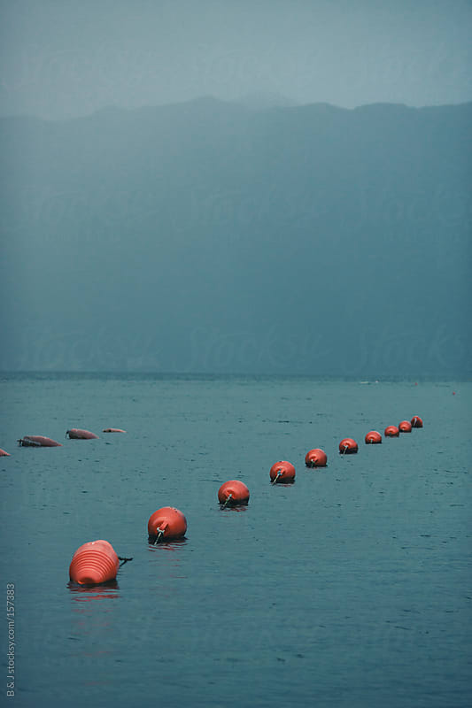 buoy in the sea by B & J for Stocksy United
