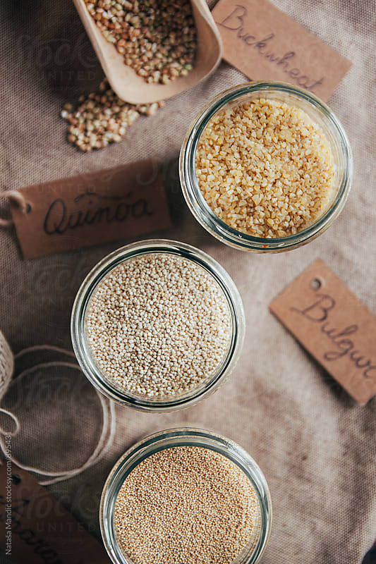 Quinoa, amaranth, bulgur and buckwheat in jars by Nataša Mandić for Stocksy United