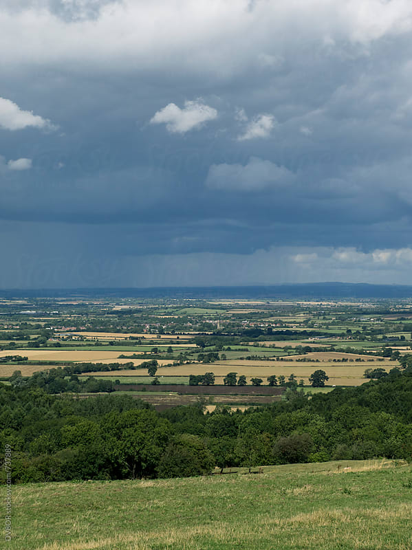 Rain falling in the distance on a view of The Cotswolds region of the English Countryside in Summer by DV8OR for Stocksy United