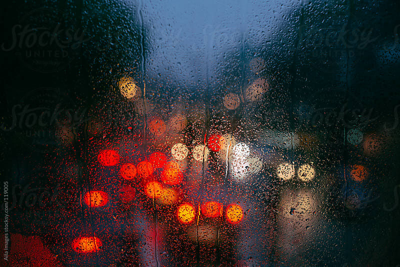 Cold Rainy Busy Street by Aila Images for Stocksy United