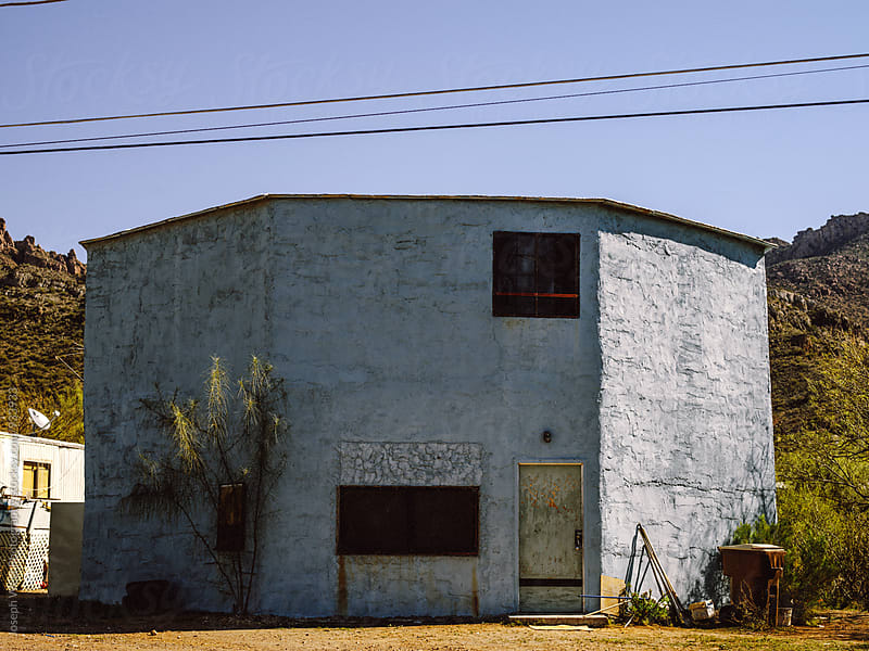 Blue building in the desert by Joseph West Photography for Stocksy United