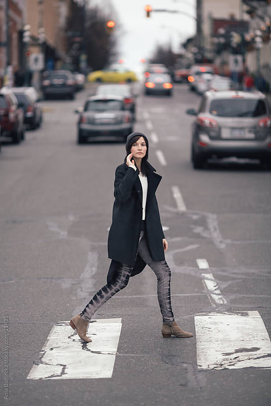 A well dressed woman crossing the street by Ania Boniecka for Stocksy United