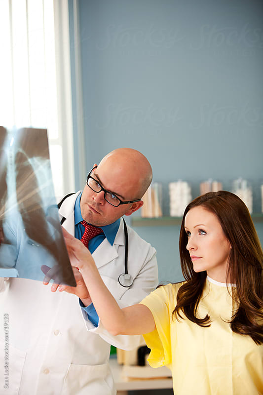 Exam Room: Woman Has Question About X-ray by Sean Locke for Stocksy United