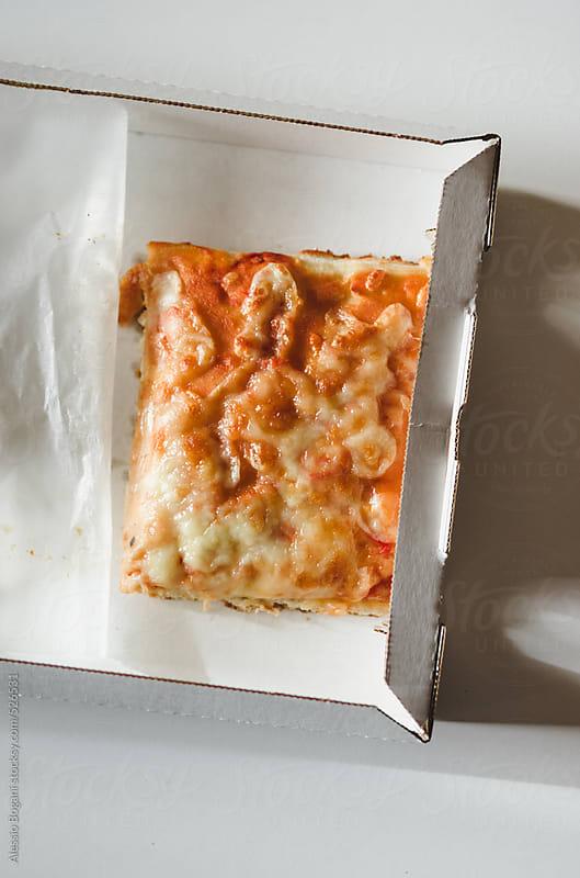 Pizza Margherita slice by Alessio Bogani for Stocksy United