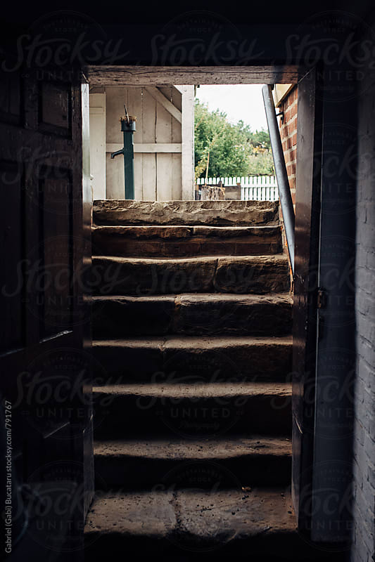 Steps from a cellar at an old farm house by Gabriel (Gabi) Bucataru for Stocksy United
